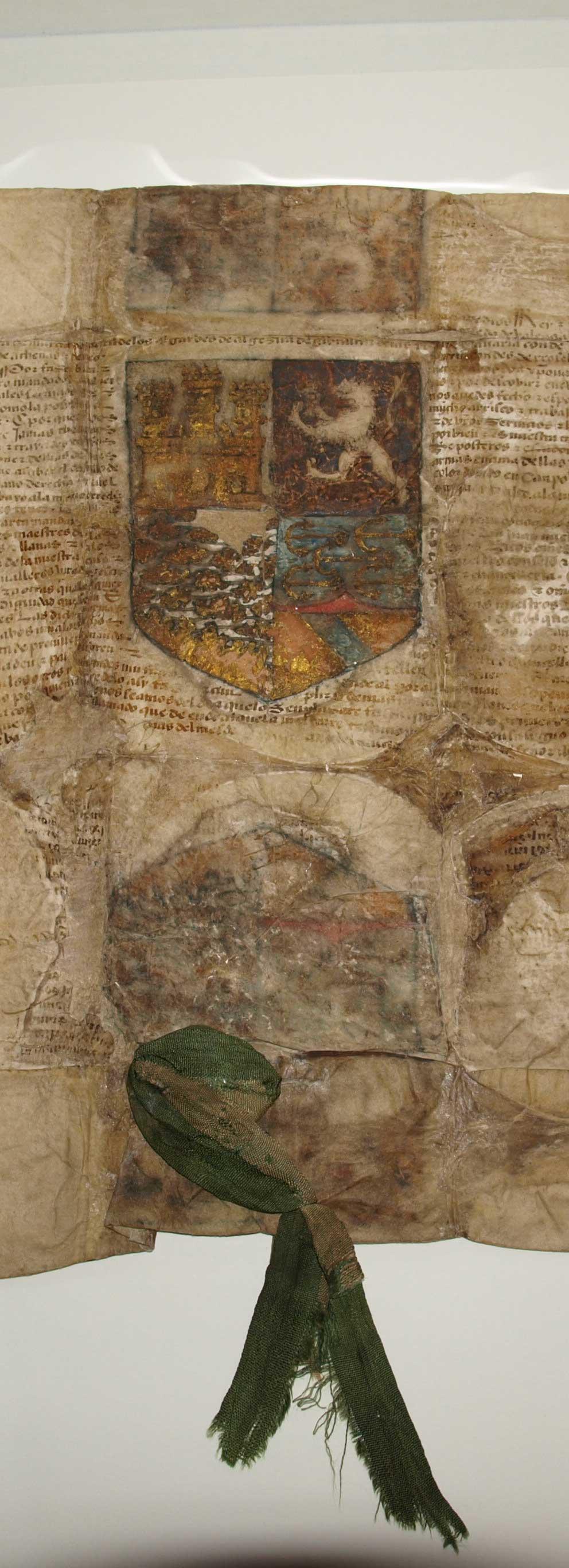 Privilegio original, sobre pergamino de vitela, que presenta la reproducción policromada de las armas que los Reyes Católicos concedieron al Descubridor de América y sus descendientes (Ansorena).